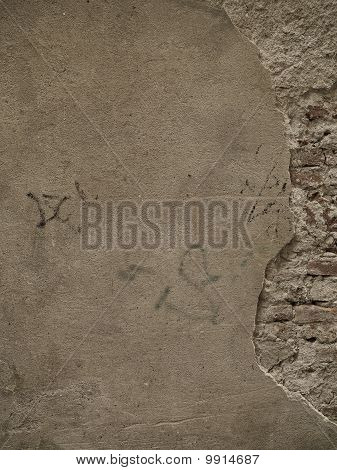 Stone Wall With Plaster And Brick