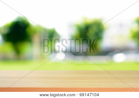 Wood Table Top On Blurry Green Nature Abstract Background