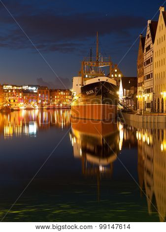 River Motlawa and ship in Gdansk by night