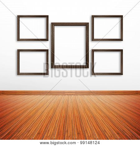 Wooden Photo Frames On White Wall Inside The Room
