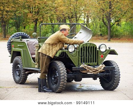 Soldier Try To Repair Soviet Military Automobile Gaz 67.