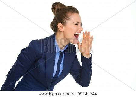 Happy Businesswoman Shouting And Cupping Hand To Mouth