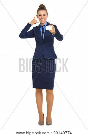 Happy Businesswoman Holding Business Card Making Telephone Sign