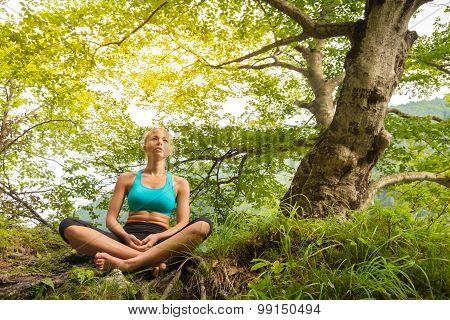 Woman relaxing in beautiful nature.
