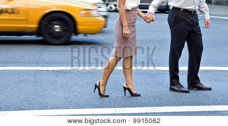 Mid section image of a couple holding hands