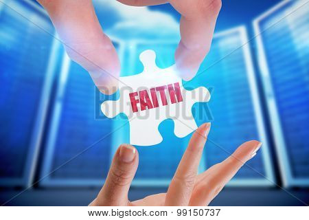 The word faith and hands holding jigsaw against composite image of server room