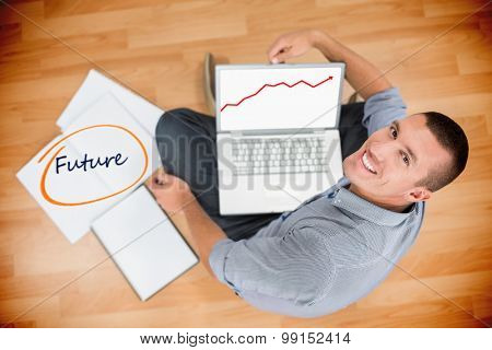 The word future and red arrow against young creative businessman working on laptop