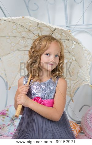 Cute cheerful child with umbrella.