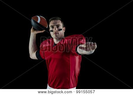 Portrait of an american football player about to throw the ball