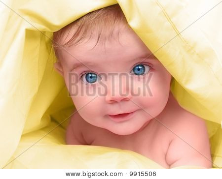 Beautiful Little Baby on Yellow Close Up