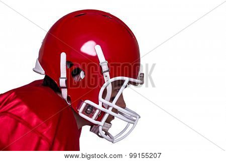 Profile view of an american football player wearing a red helmet