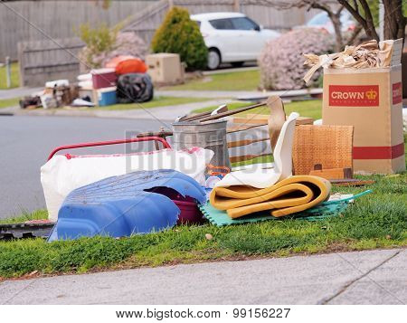 Various items in front of middle class residential housing for the annual hard rubbish collection