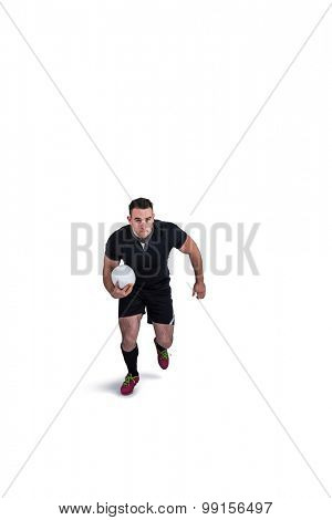 Rugby player running with the ball on white background