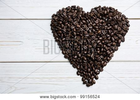 Coffee beans on a table in heart shape shot in studio
