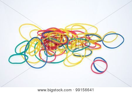 a lot of colorful rubber bands over white