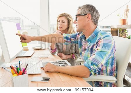 Creative design team working together on computer in the office