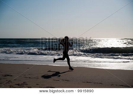 Woman running on the beach