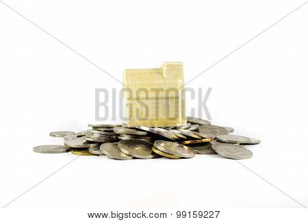 House On Top Of Coins Isolated On White Background