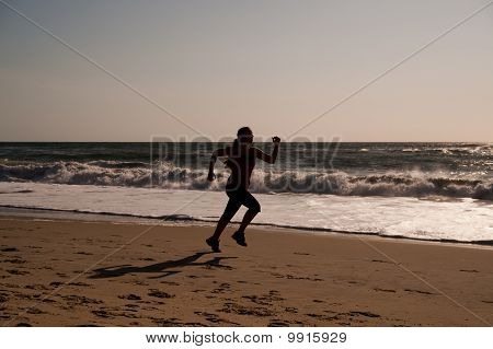 Woman running on the beach