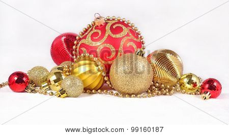 Golden And Red Christmas Decorations On A White