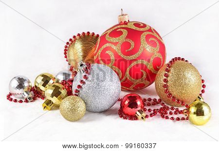 Golden, Silver And Red  Christmas Decorations On A White
