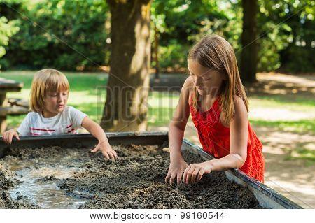 Cute kids playing in a sandbox
