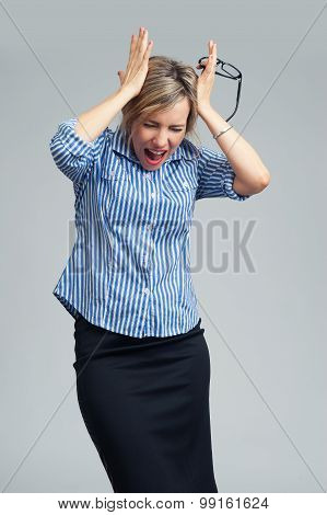 Businesswoman Screaming And Holding Head In Hands