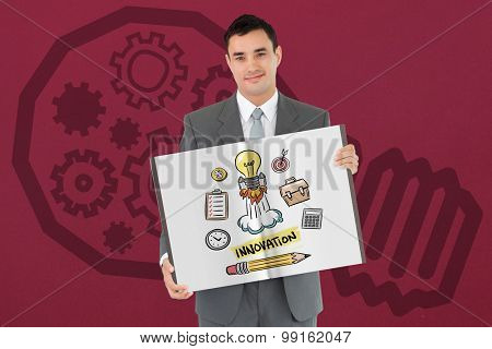 Businessman showing a book against red background