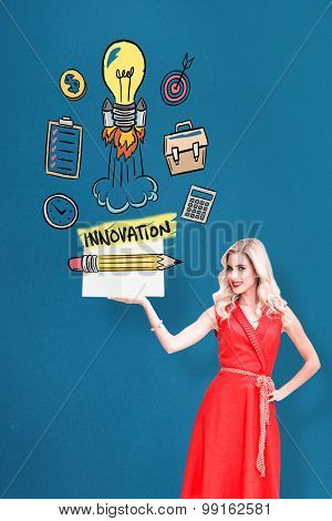 Pretty blonde showing a book against blue background