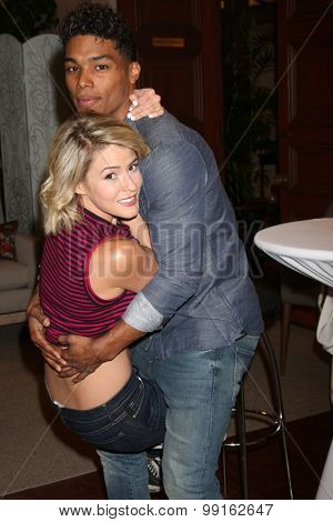 LOS ANGELES - AUG 14:  Rome Flynn, Linsey Godfrey at the Bold and Beautiful Fan Event Friday at the CBS Television City on August 14, 2015 in Los Angeles, CA