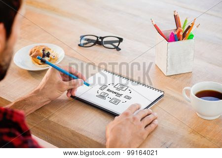 Creative businessman writing notes on notebook against responsive design doodle