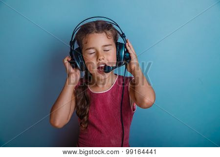 Teen girl singing in a microphone and listening to music with he