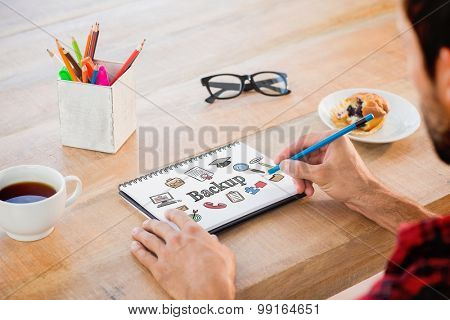 The word backup and creative businessman writing notes on notebook against business icons
