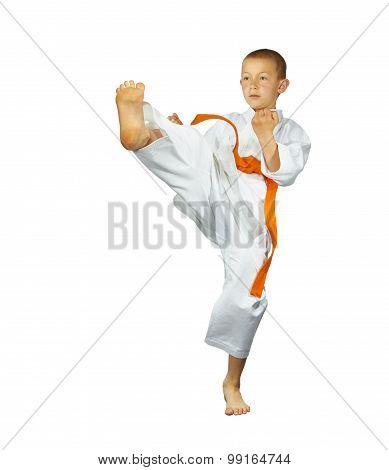 Boy is beating the blow leg forward