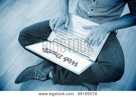 The word web traffic against young creative businessman working on laptop