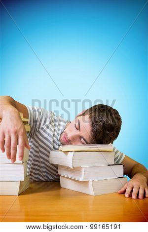 Student asleep in the library against blue background with vignette