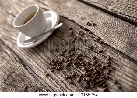 Coffee Beans And Coffee On A Rustic Table