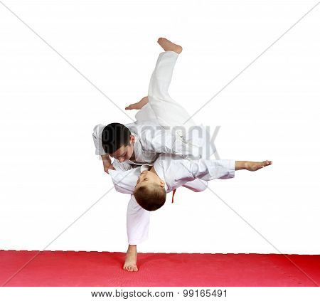 Judo throws in performing athletes in judogi