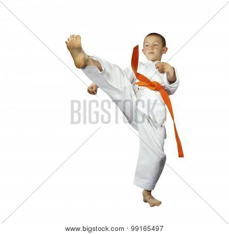 Kick leg a forward the athlete performs with an orange belt isolated