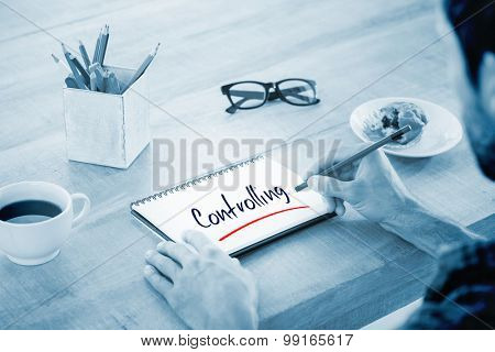 The word testing against creative businessman writing notes on notebook