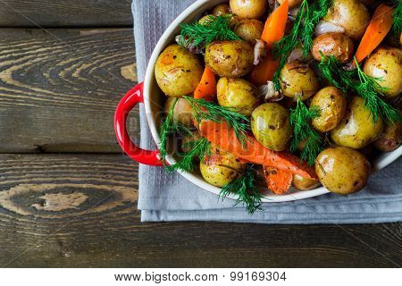 Oven-roasted potato on wooden background