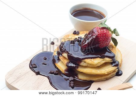 Pancakes With Chocolate Syrup And Strawberry