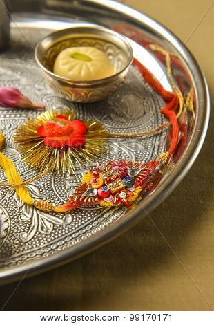 Raksha Bandhan. Traditional Rakhis placed in a decorative plate with sweet.