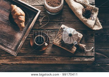 Coffee Cup And Ingredients On Old Wooden Table In Evening Window Light