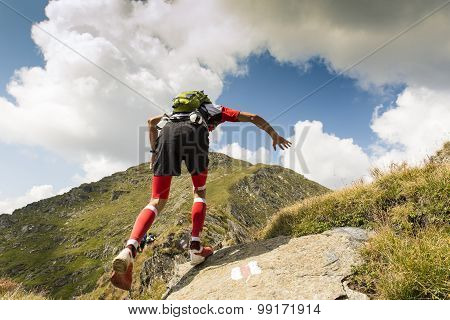 Hiker running on mountain