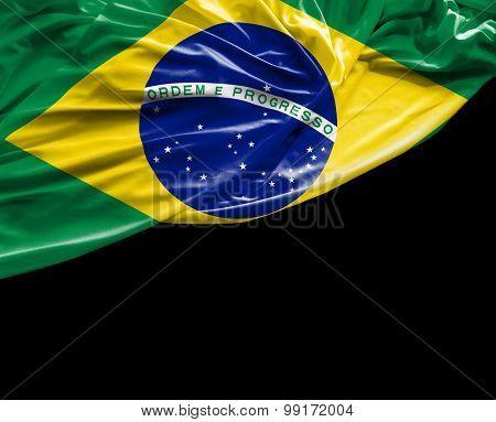 Brazilian waving flag on black background