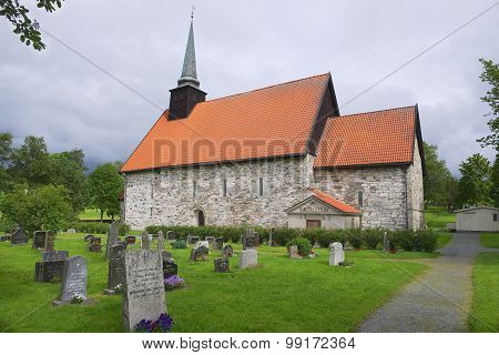 Exterior of the medieval Stiklestadt church and cemetery in Stiklestadt, Norway.