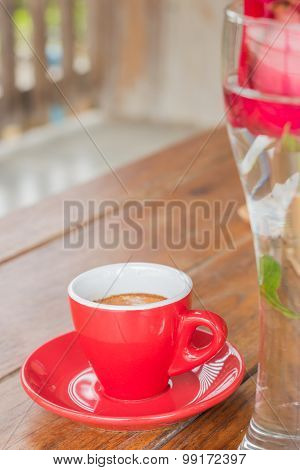 Hot Espresso Serving On Wooden Table