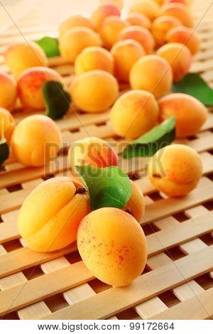 Ripe apricots on wooden lattice background