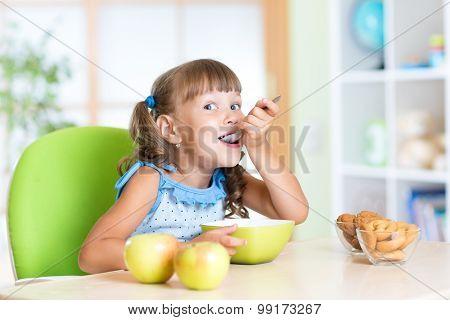 Child eats tasty breakfast